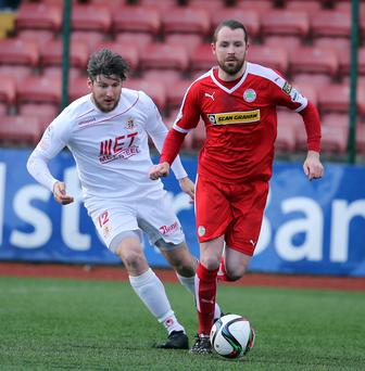 Mind games: Cliftonville's Marc Smyth battles with Portadown's Ken Oman
