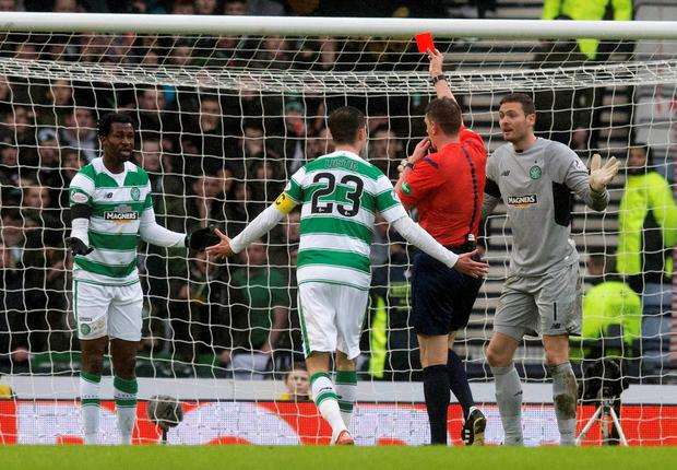 Crucial moment: Celtic's Efe Ambrose is sent off by Craig Thompson, which proved the turning point in the game