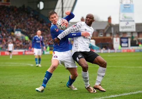 Tight tussle: Antony Sweeney of Carlisle United battles for the ball with Arouna Kone of Everton