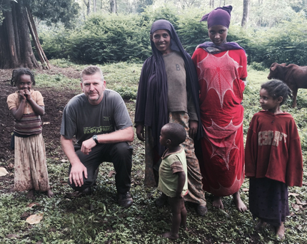 Moy Park director Alan Gibson meets local children on the Bale Mountain Trek in Ethiopia