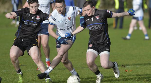Drawing attention: UUJ ace Evan Regan finds himself under pressure from two Garda College players in the Sigerson Cup