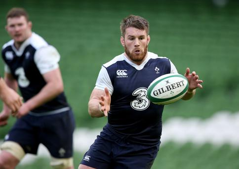 Hands on: Sean O'Brien gears up for the start of Ireland's Six Nations title defence against Wales, and he is prepared for a tough battle against Warren Gatland's side's physical back-rowers