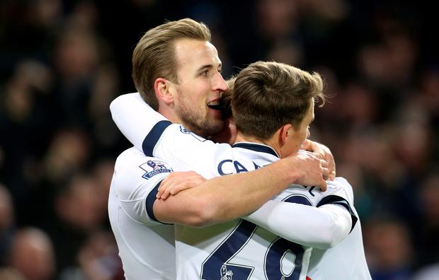 Tottenham Hotspur's Harry Kane (left) celebrates scoring his side's third goal of the game with teammates during the Barclays Premier League match at Carrow Road, Norwich. PA