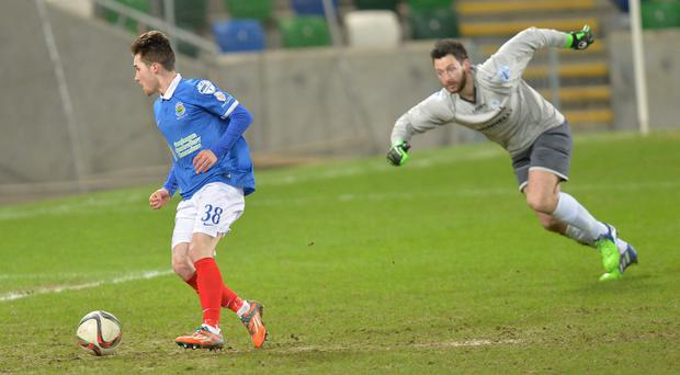 Calm and collected: Paul Smyth rounds Swifts goalkeeper Andy Coleman to send the ball into the net for Linfield's second goal