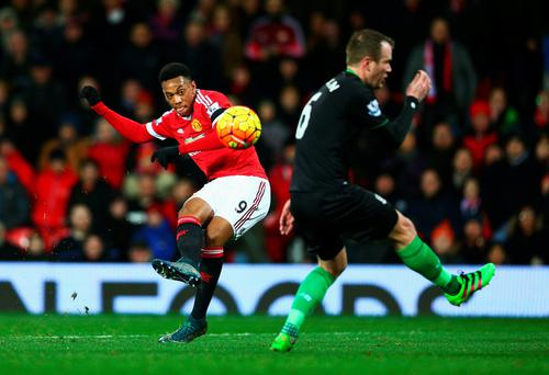 Touch of class: Anthony Martial scores United's second goal against Stoke last night at Old Trafford