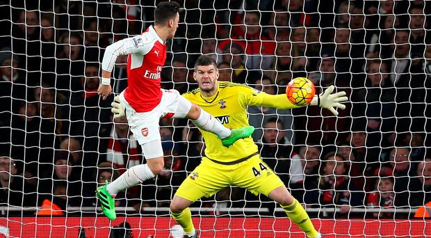 No way through: Fraser Forster keeps out Mesut Ozil as the Gunners lose ground in the race for the Premier League crown