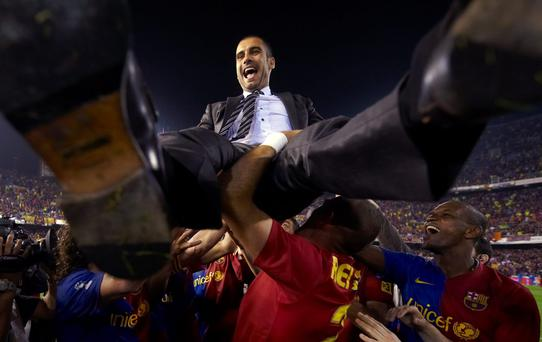 High point: Pep Guardiola is hailed by his former Barca players after winning the Copa del Rey