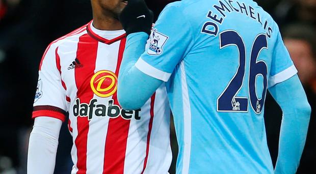 Up close: Martin Demichelis and Jermain Defoe square up