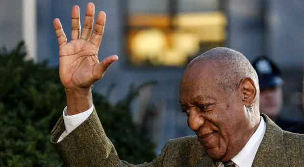 US comedian Bill Cosby waves as he leaves the Montgomery County courthouse in Norristown, Pennsylvania on February 2 , 2016.KENA BETANCURKENA BETANCUR/AFP/Getty Images