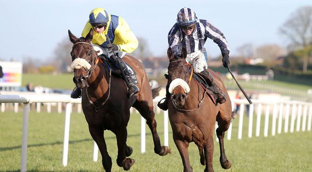 Local heroes: Ulster-owned Steamboat Bill (right) wins the opener with Jack Kennedy in the saddle at Down Royal