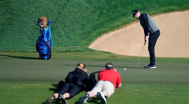Taking aim: Rory McIlroy of putts on the seventh green during the pro-am event prior to the Omega Dubai Desert Classic