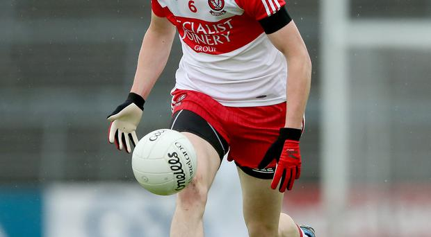 Injury woe: Derry's Brendan Rogers needed stitches after a clash wit Tyrone's Tiernan McCann