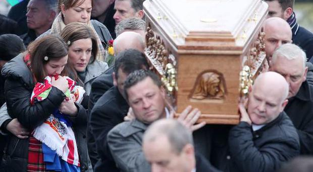 Funeral of former Derry City FC striker, Mark Farren, has takes place in County Donegal. Mr Farren had been receiving treatment for an aggressive brain tumour. Hundreds of mourners gathered for the service in Ballybrack near Moville. His coffin is taken from St Mary's Church to be buried in the adjourning graveyard followed by his wife Terri. Picture by Jonathan Porter/PressEye