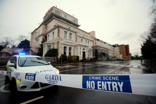 A Garda cordon outside the Regency Hotel in Dublin in February. PA