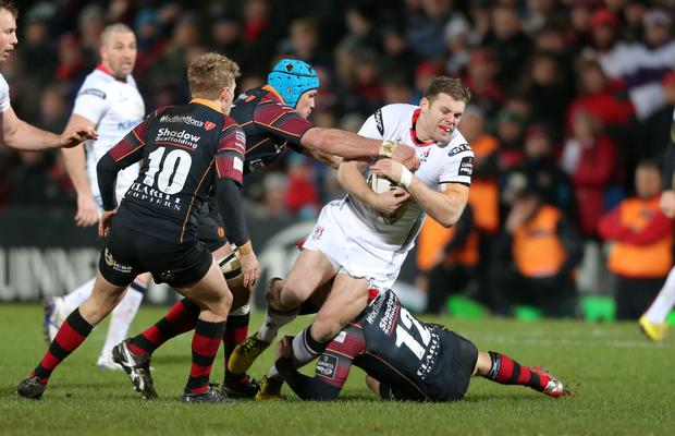 Guinness PRO12 Ulster v Newport Gwent Dragons at Kingspan Stadium, Belfast. Ulster's Darren Cave is tackled by the Dragons Ben White and Adam Warren