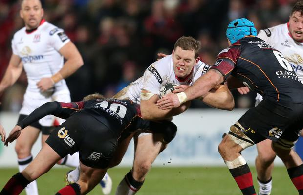 Guinness PRO12 Ulster v Newport Gwent Dragons at Kingspan Stadium, Belfast. Ulster's Darren Cave is tackled by the Dragons Ben White and Angus O'Brien. Picture by Darren Kidd / Press Eye.