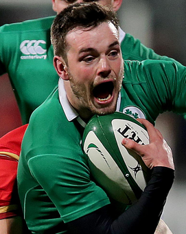 On the charge: Ireland's Matthew Byrne makes a break