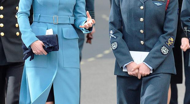 The Duchess of Cambridge (left) walks from St Clement Danes Church in Lonodn to the Royal Courts of Justice, for a reception to mark 75th anniversary of the forming of the RAF Air cadets. John Stillwell/PA Wire