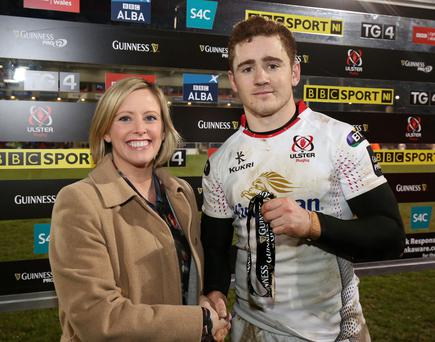 Top man Jacko: sponsors representative Claire Hutchinson of Diageo with Ulster's man of the match against Dragons, Paddy Jackson, after he kicked winning points