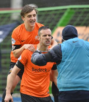 Emotional: Ciaran Martyn is congratulated on his goal by Joel Bradley and manager Gary Hamilton