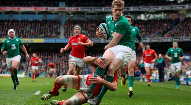 Tipping point: Andrew Trimble is taken down by Justin Tipuric of Wales in yesterday's 16-16 draw at the Aviva