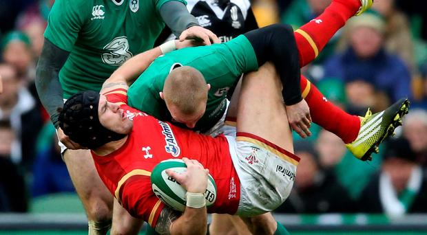 Tipped over: Ireland's Keith Earls stops Tom James of Wales in his tracks at the Aviva Stadium