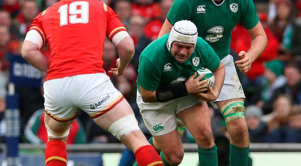 On the run: Rory Best tries makes strides for Ireland in the draw against Wales