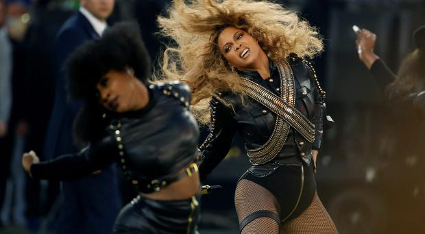 In this Sunday, Feb. 7, 2016 file photo, Beyonce performs during halftime of the NFL Super Bowl 50 football game in Santa Clara, Calif. Beyonce is working overtime this weekend: After releasing a new song Saturday and performing at the Super Bowl on Sunday, she's announced a new stadium tour. The Grammy-winning singer announced her 2016 Formation World Tour in a commercial after she performed at the halftime show with Bruno Mars and Coldplay. (AP Photo/Matt Slocum, File)