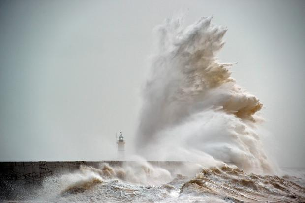 Waves crash over Newhaven Lighthouse on the south coast of England on February 8, 2016, as the latest storm hits the UK and Ireland. AFP/Getty Images