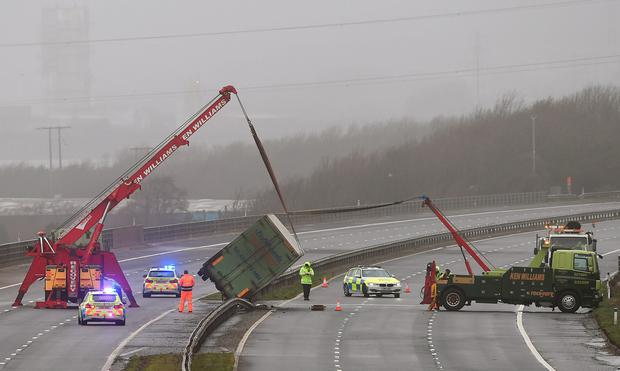 Recovery vehicles work to right an overturned lorry on the M4 between Bridgend and Port Talbot as winds of nearly 100mph battered Britain after Storm Imogen slammed into the south coast bringing fierce gusts and torrential downpours. PA