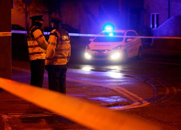 Garda officers attend the scene on Poplar Row, North Strand following the shooting of a second man in Dublin, in an apparent gangland feud which is suspected to involve drugs gangs in Ireland and Spain. PA