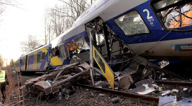 The axis sits separated from the carriage at the site of a train accident near Bad Aibling, Germany, Tuesday, Feb. 9, 2016 (Josef Reissner/dpa via AP)