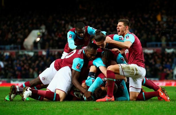Angelo Ogbonna Obinza of West Ham United is mobbed in celebration by team mates as he scores their second goal during the Emirates FA Cup Fourth Round Replay match between West Ham United and Liverpool at Boleyn Ground on February 9, 2016 in London, England. (Photo by Clive Rose/Getty Images)