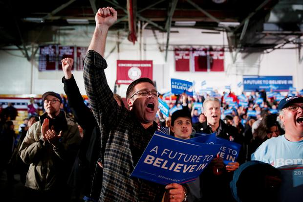 Bernie Sanders supporters react to television predictions of Sanders winning the Democratic New Hampshire Primary at the candidate's New Hampshire Primary Night watch party to begin February 9, 2016 in Concord, New Hampshire.