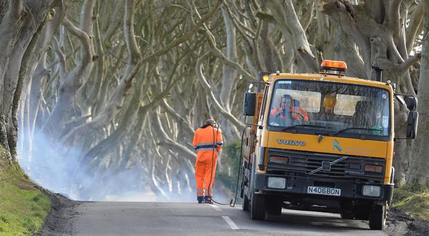 White Lines are removed from the Road at the Dark Hedges, The trees which feature in Game of Thrones and are one of Northern Ireland's most famous natural landmarks, Fans of north Antrim's Dark Hedges showed concern that road markings painted by mistake have spoiled their look. Photo Colm Lenaghan/pacemaker press
