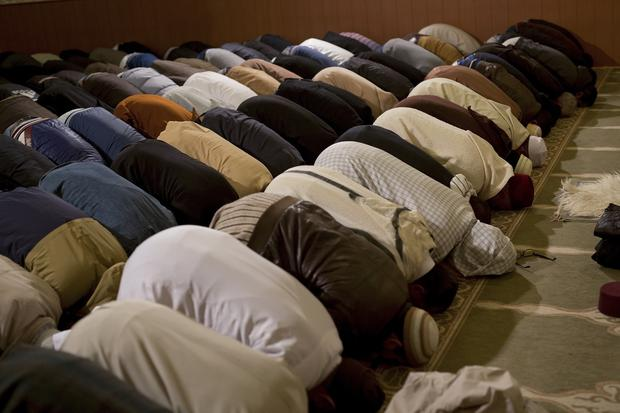 Muslim men pray during the celebration of the Mawlid, which marks the anniversary of the birth of Prophet Mohammed
