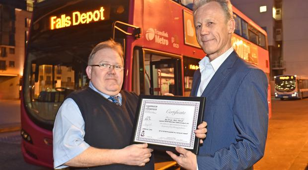 Pictured during the presentation are l-r Paul Doyle, Translink Metro bus driver and PR Smith, National Campaign for Courtesy Non Executive Director. Paul, a Metro driver based in Falls Road bus depot in West Belfast, hit media headlines worldwide at the end of 2015 for a simple act of generosity in which he presented a winter coat to someone in need. Pic: Simon Graham/Harrisons
