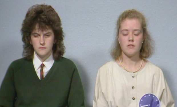 A young Arlene Foster is interviewed by Jeremy Paxman alongside catholic schoolgirl Madonna Murphy. Still from BBC Spotlight video