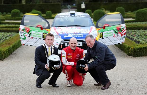 Rallying call: Looking forward to a brand new Circuit qualifying stage based at Antrim Castle Gardens is Jonny Greer. The Citroen DS 3R3 driver from David Greer Motorsport is pictured with Mayor of Antrim and Newtownabbey, Cllr Thomas Hogg (left) and Bobby Willis (right) Circuit of Ireland Event Director