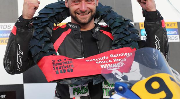 Ell of a man: Seamus Elliott celebrating his Southern 100 success