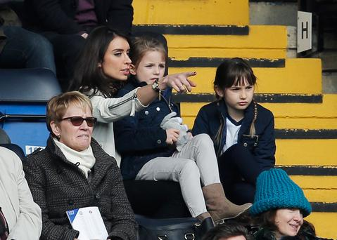 Christine Bleakley sits with Frank Lampard's daughters Isla and Luna during the Barclays Premier League match between Chelsea and Sunderland at Stamford Bridge