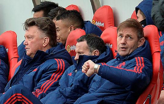 Manchester United's Dutch manager Louis van Gaal (L) sits in the dug out with Manchester United's Welsh assistant manager Ryan Giggs (C) during the English Premier League football match between Sunderland and Manchester United at the Stadium of Light in Sunderland, northeast England on February 13, 2016. Sunderland won the match 2-1. / AFP / OLI SCARFF /