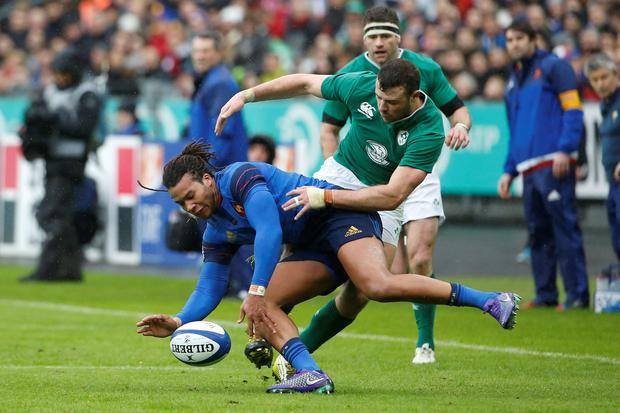 France's wing Teddy Thomas (L) fights for the ball with Ireland's fullback Robbie Henshaw during the Six Nations international rugby union match between France and Ireland at the Stade de France Stadium in Saint-Denis, north of Paris, on February 13, 2016. AFP PHOTO / THOMAS SAMSONTHOMAS SAMSON/AFP/Getty Images