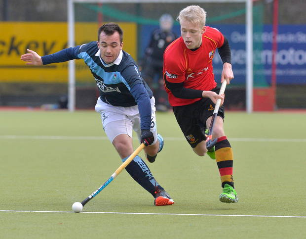 Head to head: Richard Arneill (left) of hosts Lisnagarvey, battles for possession with Banbridge's Peter Brown