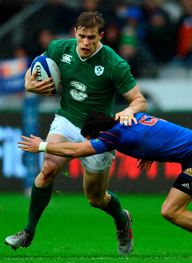 On the run: Andrew Trimble is halted by Sebastien Bezy