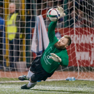 Safe hands: Ards' Ryan Brown makes a save against Cliftonville