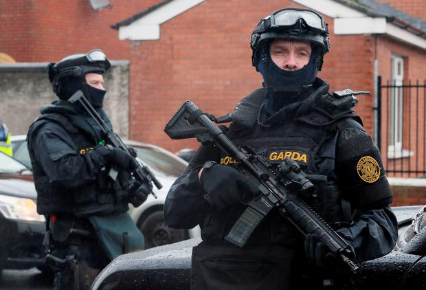 Armed Gardai from the forces Emergency Response Unit on patrol in North Inner City Dublin after gang violence resulted in two murders in four days. Niall Carson/PA Wire