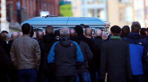 The coffin is carried into St Nicholas of Myra church on Francis Street in Dublin, during the funeral of David Byrne, who was shot dead during a boxing weigh-in at the Regency Hotel in the north of the city on Friday February 5 by a six strong gang, some armed with assault rifles. Niall Carson/PA Wire