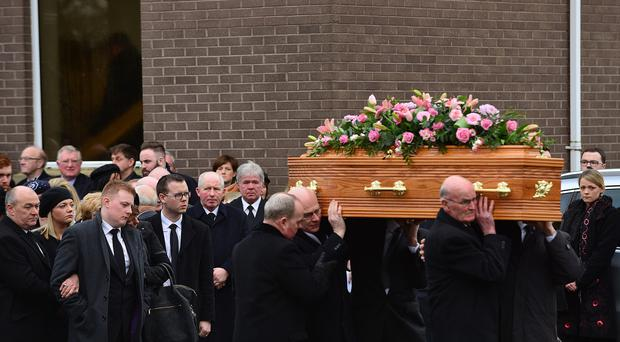 Pacemaker Press Belfast 15-02-2016: The funeral of Karla Cameron, who died in a two-vehicle collision near Ballymena on Thursday, was held at a thanksgiving service on Monday, February 15 in Ballee Baptist Church. Karla, 25, from the Ballymena area, died on Thursday evening from injuries sustained in the early morning collision. Family members, friends and Karla's husband David pictured at the Funeral. Picture By: Arthur Allison.