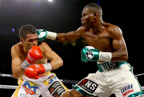 Packing a punch: Guillermo Rigondeaux, pictured landing a blow on Drian Francisco, wants to prove he is the best 122lb fighter on the planet by taking on the winner of Carl Frampton's World title unification fight with Scott Quigg